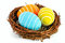Stock Image : Easter eggs in a nest on a white background.