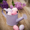 Stock Image : Easter eggs in watering can