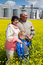 Stock Image : Elderly couple with grandchild on rapeseed field