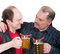 Stock Image : Elderly men holding a beer belly