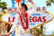 Stock Image : Elvis look-alike impersonator and Las Vegas sign