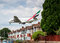 Stock Image : Emirates Airbus A380 plane landing over houses