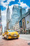 Stock Image : Empire State building and yellow taxi cab on the street