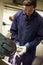 Stock Image : Engineer Using Grinding Machine In Factory
