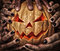 Stock Image : Evil pumpkin with glowing eyes that are holding