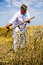 Stock Image : Farmer cutting wheat