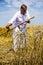 Stock Image : Farmer cutting wheat