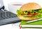 Stock Image : Fast food near laptop