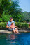 Stock Image : Father and daughter near swimming pool
