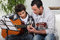 Stock Image : Father teaching son the guitar