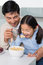 Stock Image : Father with young daughter having cereals in kitchen