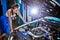 Stock Image : Female auto mechanic repairing a car