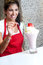 Stock Image : Female chef serving strawberry shake