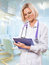 Stock Image : Female doctor clipboard and writing in it
