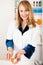 Stock Image : Female Pharmacist with Prescription
