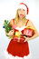 Stock Image : Female Santa Claus in trouble with too many packages