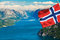 Stock Image : Fjord in Norway with flag