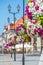Stock Image : Flower arrangement on street lamp