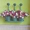 Stock Image : Flowers in metal watering can, Vintage style