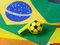 Stock Image : Football shape whistle on brazil flag