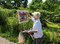 Stock Image : France/Giverny: Artist at Work in Rue Claude Monet