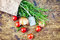 Stock Image : Fresh rosemary with tag, red and green tomatoes on rustic wooden