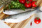 Stock Image : Fresh sea grey mullet on cutting board