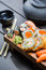 Stock Image : Fresh sushi on wooden board served with tea