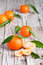 Stock Image : Fresh tangerines with leaves