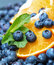Stock Image : Freshly picked blueberries with orange