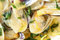 Stock Image : Fried beam clams in olive oil close-up