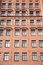 Stock Image : Front view of brick wall contemporary apartment building with windows