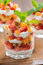 Stock Image : Fruit dessert with whipped cream and granola, close-up
