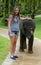 Stock Image : Girl with baby elephant