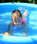 Stock Image : Girl bathes in inflatable pool