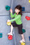 Stock Image : Girl climbing rock wall