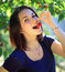 Stock Image : Girl eating cherry