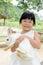 Stock Image : Girl holding rabbit