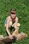 Stock Image : Girl with lying dog