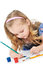 Stock Image : Girl paints paints