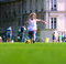 Stock Image : Girl playing football in front the school building