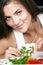 Stock Image : Girl prepares salad