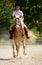 Stock Image : Girl riding pony