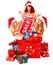 Stock Image : Girl in Santa hat holding Christmas gift box.