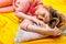 Stock Image : Girl sleeping on the yellow sheet