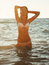 Stock Image : Girl stands in the sea