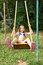Stock Image : Girl swinging on a swing