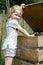 Stock Image : Girl throwing rubbish into bin