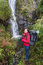 Girl tourist photographs waterfall. Portugal .