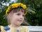 Stock Image : Girl with wreath of dandelions on head